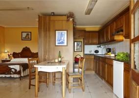 Apartamentos sala de estar cocina y dormitorio