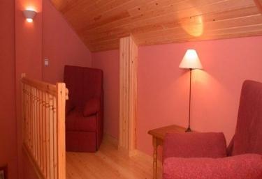 Habitación doble butacas camas