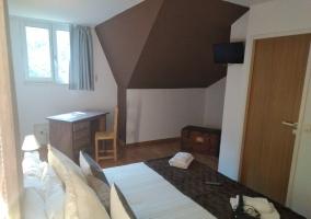 Dormitorio y aseo