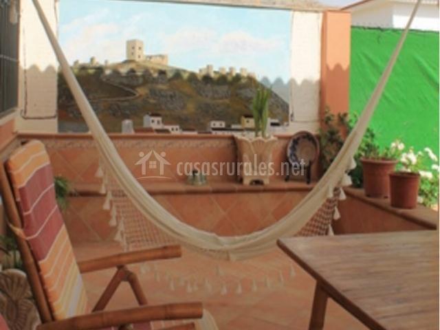 Vistas de la terraza con hamaca de tela