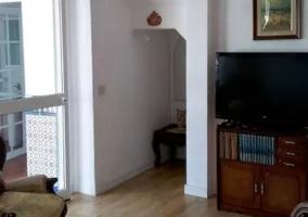 Sala de estar con butacas tapizadas