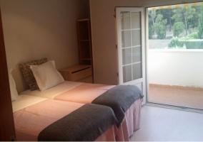 Dormitorio doble con salida a la terraza