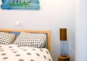 Dormitorio de matrimonio en tonos azules y blancos
