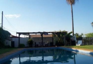Casas rurales con piscina en punta umbria for Casas rurales en badajoz con piscina