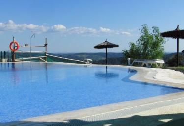 Casas rurales con piscina en santa ana la real for Complejo rural con piscina