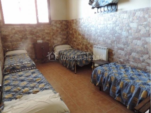 Dormitorio con colchas