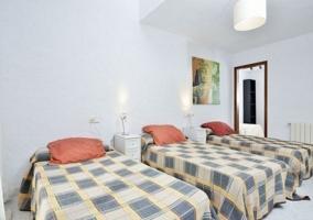 Dormitorio triple con camas individuales