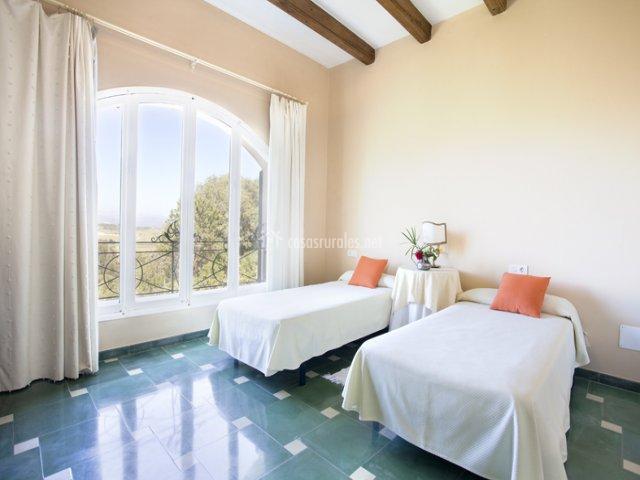 Habitación con 2 camas de Casa de Invitados