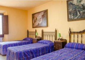Dormitorio de matrimonio y dos individuales