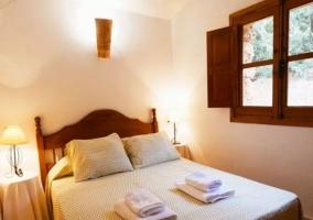 Dormitorio 7 de la casa con mesilla
