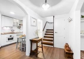 Recibidor y escaleras de la casa