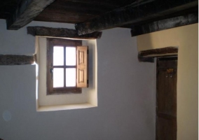 Dormitorio de matrimonio con cabecero original