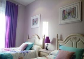 Dormitorio doble con muebles