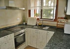 Cocina de la casa con forma de U