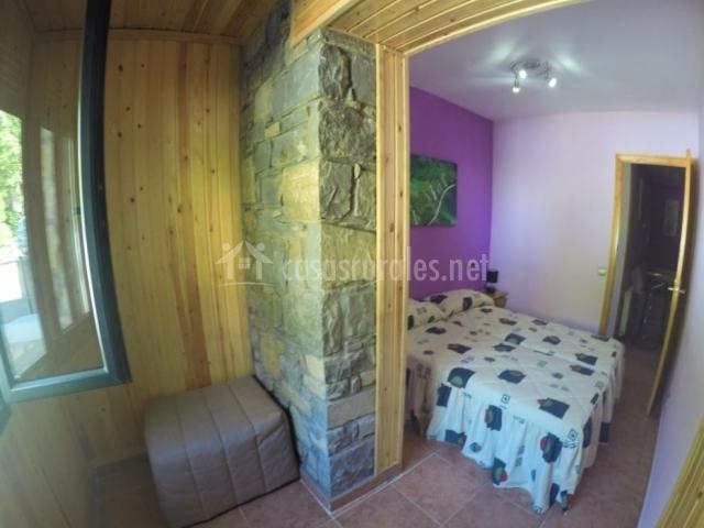 Dormitorio doble con paredes