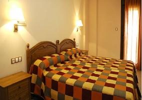 Dormitorio doble con radiador