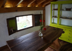 Attic kitchen with wooden table and benches