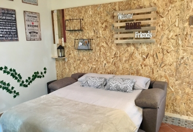 Sofá cama con detalles