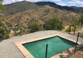 Vistas de la piscina de la casa vallada