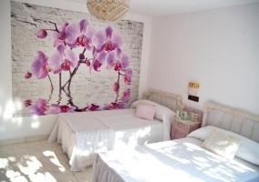 Dormitorio doble con pared y sus detalles