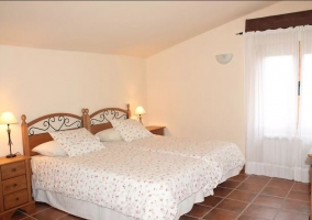 Dormitorio doble con colchas