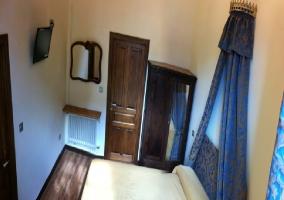 Habitación Huidobro con su cama de matrimonio
