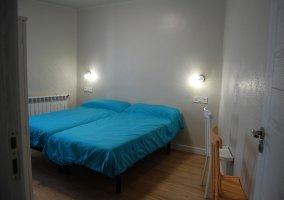 Dormitorio 6 con un par de camas juntas