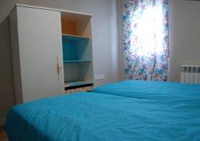 Dormitorio 6 con un par de camas