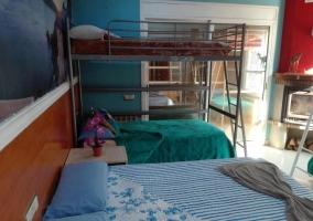 Dormitorio 4 con varias camas