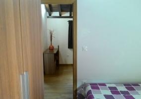 Dormitorio doble comunicado con otras estancias