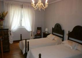 Dormitorio doble con las camas individuales