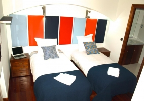 Dormitorio doble y aseo integrado