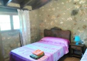 Dormitorio triple con su cama de matrimonio