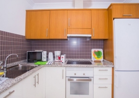 Kitchen of the house with cupboards in white