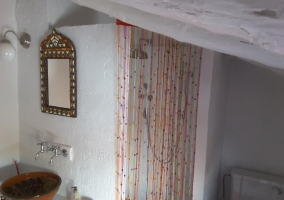 Toilet of the house with a shower in white