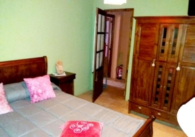 Double bedroom with wooden wardrobe