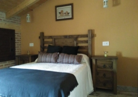 Bedroom with double bed and wooden headboard