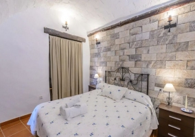 Bedroom with double bed and towels