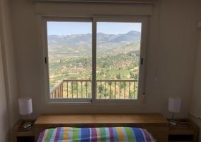 Dormitorio con vistas impresionantes