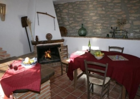 Kitchen with fireplace and dining table next