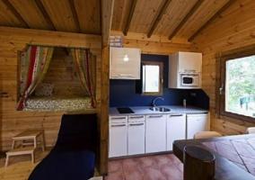 Acceso a la casa con estructura en madera