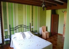Dormitorio de matrimonio en color verde