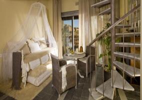 Suite con dos pisos y escaleras