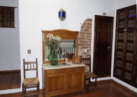 Large porch of the house with a table set