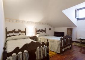 Dormitorio con estilo rústico