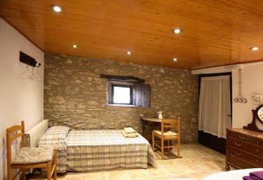 Dormitorio con las camas individuales
