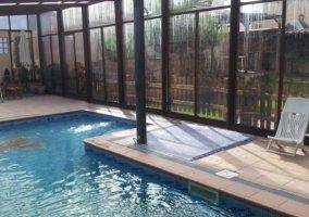 Vistas de la piscina con el acristalamiento