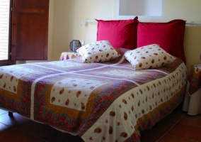 Double bed with fabric headboard