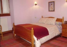 Double room with pink wall