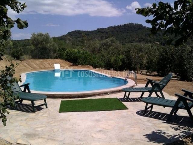 Mas fullat en alforja tarragona for Hamacas de piscina